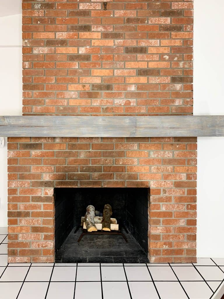 diy fireplace makeover on a budget: before and after painting red brick fireplace to white on a budget