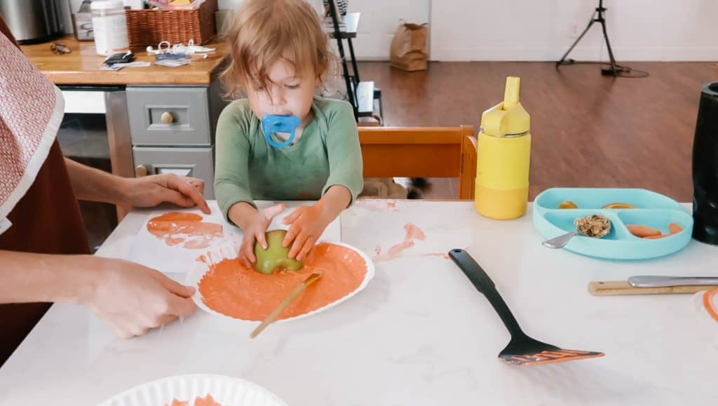 Halloween Activity: Apple Stamped Pumpkin Craft For Young Children